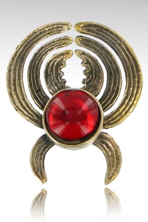 Un bijou de sein unique composé d'une pince pour téton en bronze sertie  de son cristal (7 couleurs).